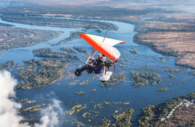 Flyings on hang glider under Victoria Falls