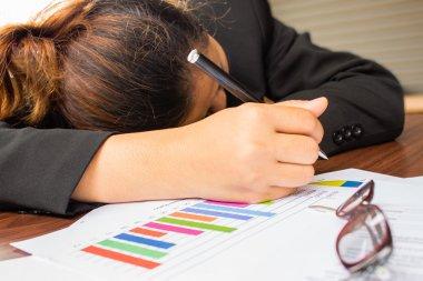 Tired businesswoman sleeping at work.