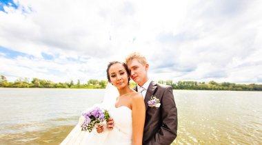 wedding couple  near water