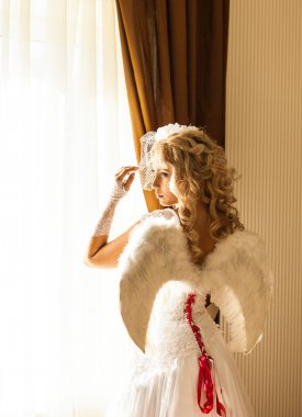 silhouette of beautiful  woman with angels wings. Angel with long curly hair.