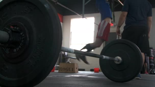 People working out in a cross-fit type gym