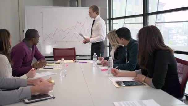 Attractive professional men and women are involved in a meeting