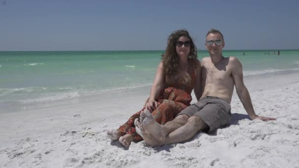 A couple enjoys a romantic beach at a resort