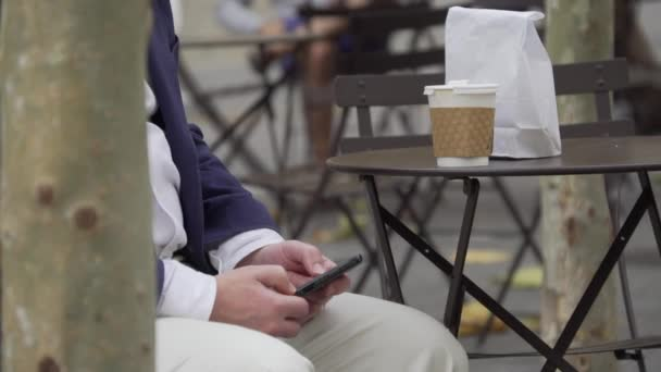 A man uses his phone on a new York city street