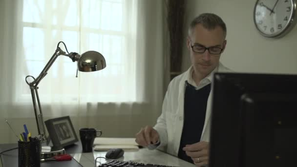 A medical doctor at his office desk
