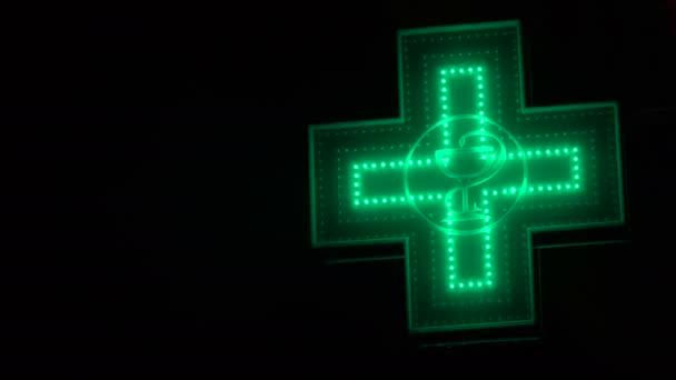 Iluminated Green Pharmaceutical Cross. Pharmacy Street Sign