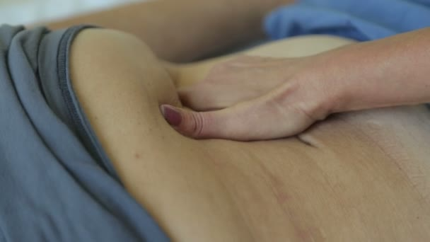 abdominal palpation examination in medical office