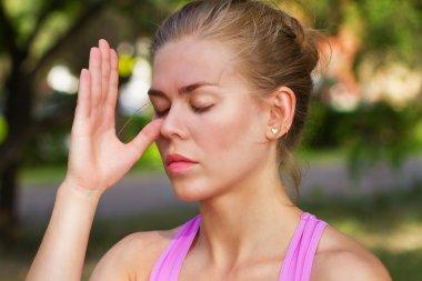 girl doing breathing exercises. pranayama and yoga.