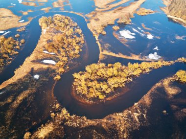 Spring melting river flood aerial panorama. Overflow water at springtime. Rural sunrise landscape. Meadows covered by water. Flood-land near Neman, Belarus. Top View