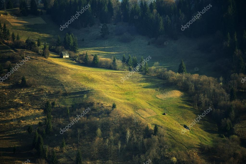Spring green hillsides. Sunny April in mountains.