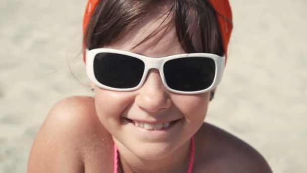 Teenager girl in sunglasses smile