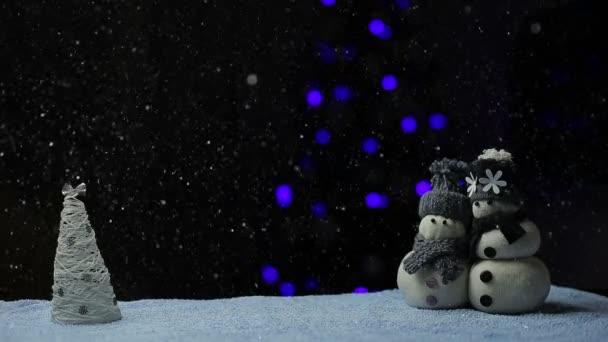 Schneemannpaar in der Schneenacht