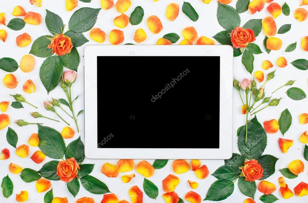pattern of fresh roses with tablet with blank screen