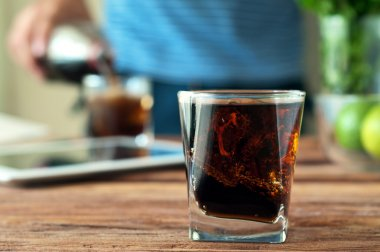 Cola in a glass with glass