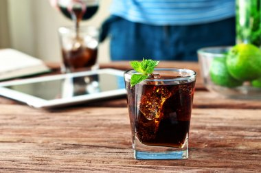 glass of cola with ice and mint