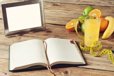 open notebook, fruit, juice on the table