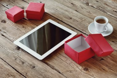 Gifts with a white tablet computer