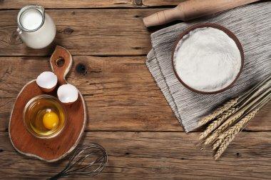 Flour, milk, eggs, in the bakery on a rustic table