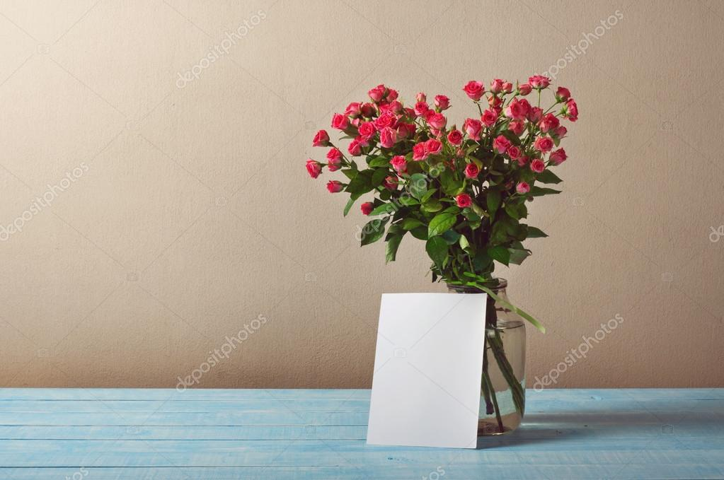 Bouquet of roses with a blank greeting card