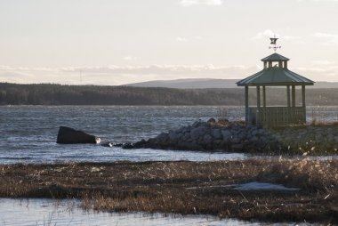 gazebo on the shore of the Gulf of Bothnia facing the municipality of Hudiksvall in Sweden