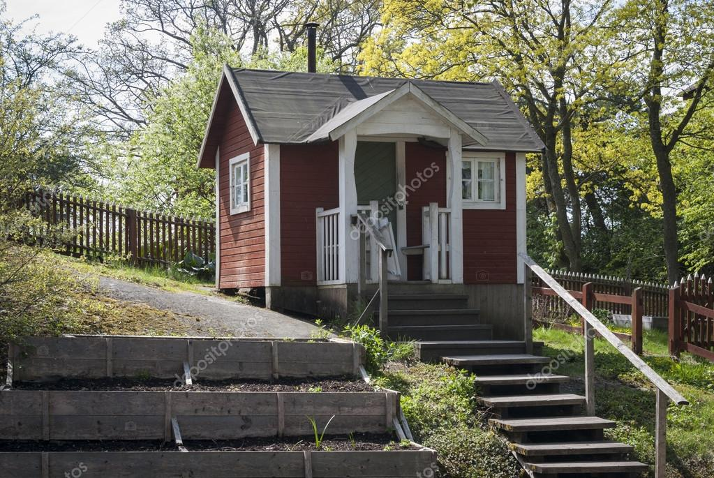 Small wooden house painted in red color stock photo for Mini wooden house