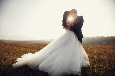 Romantic fairytale newlywed couple hug