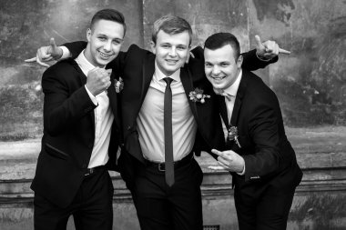 Handsome stylish groom and groomsmen