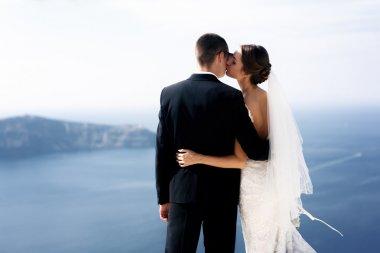 Romantic beautiful couple hugging on terrace