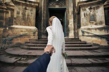 Beautiful bride leading groom
