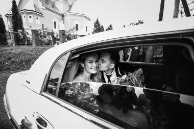 Happy romantic newlyweds kissing