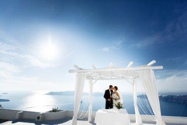 Happy married couple kissing on terrace