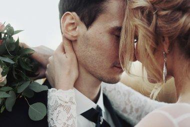 Sensual bride and groom hugging