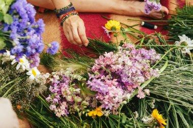 Woman making flower wreaths