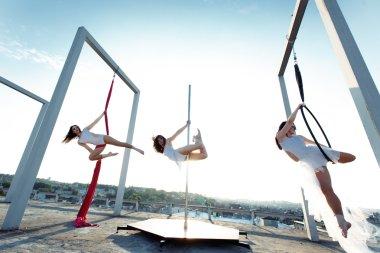 Athletic dancers performing on rooftop