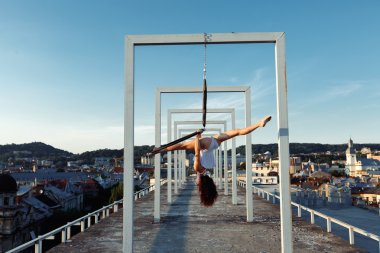 Aerial dancer on rooftop