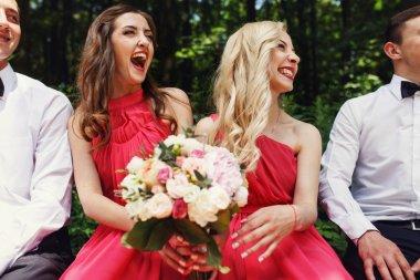 Groomsmen and bridesmaids laughing
