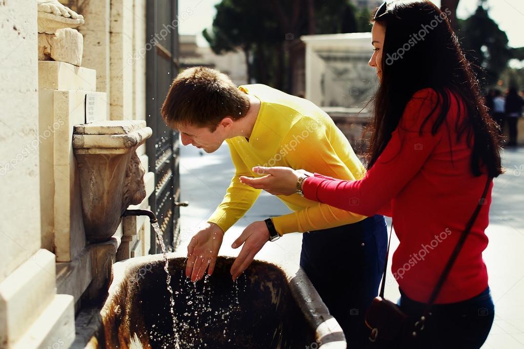 Couple in love near the fountain in the garden Vatican Museum in