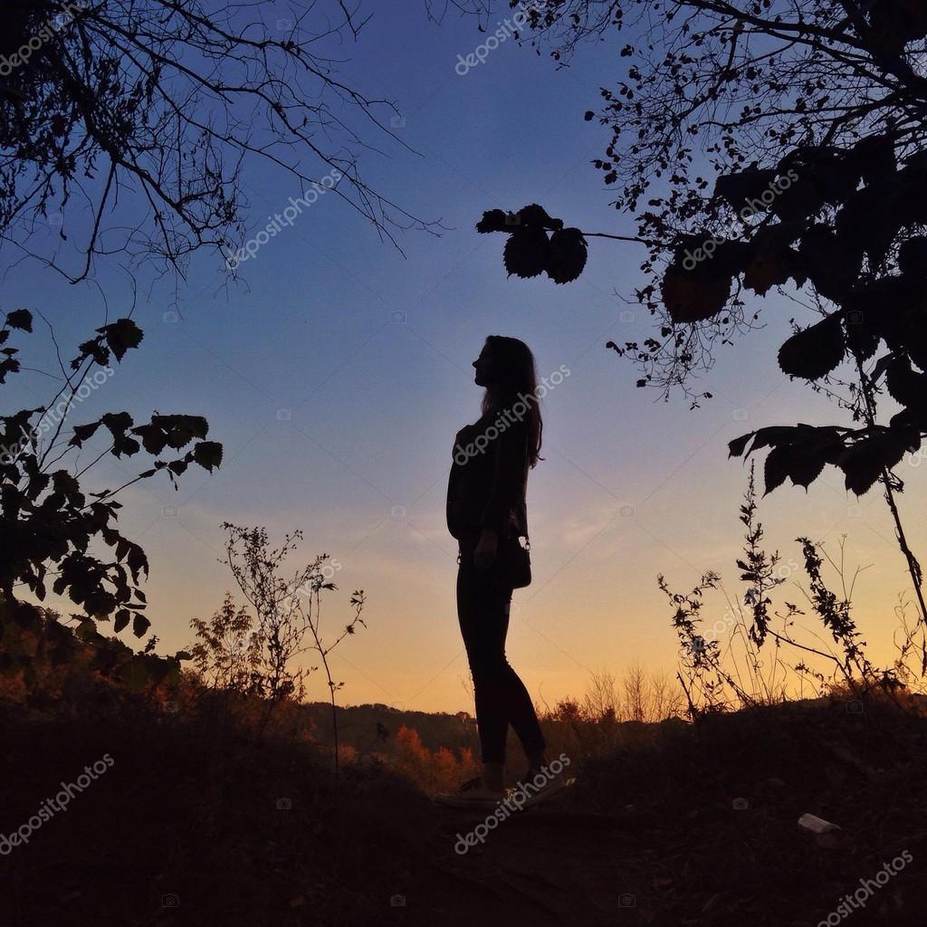 Girl in autumn evening