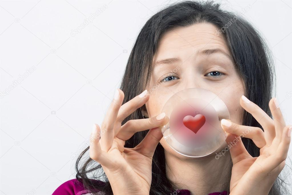 Girl With Slitted Eyes Holding A Glass With A Red Heart Symbol