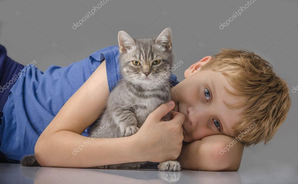 Happy child with kitten