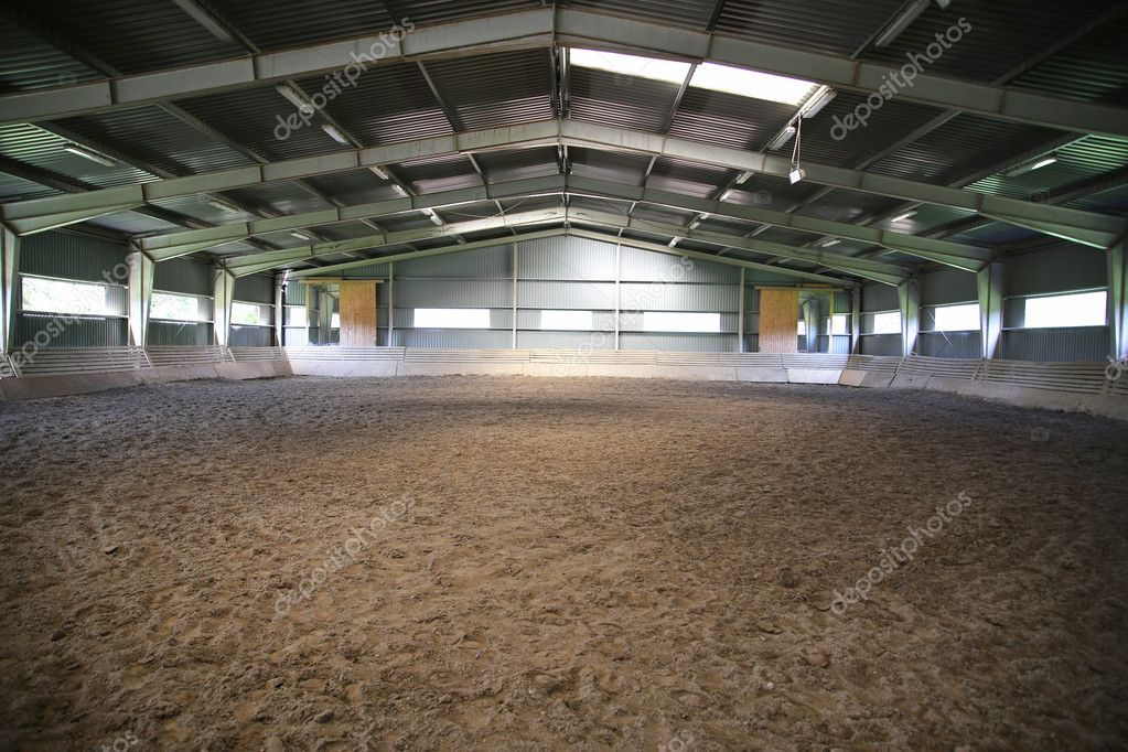 View an indoor riding arena backlight — Stock Photo