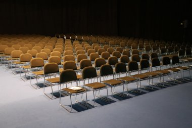 Endless rows of chairs in a modern conference hall