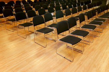 Rows of empty chairs in a seminar hall