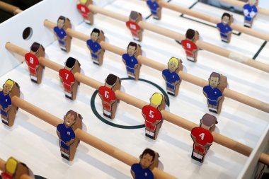 Retro soccer table game players. Selective focus
