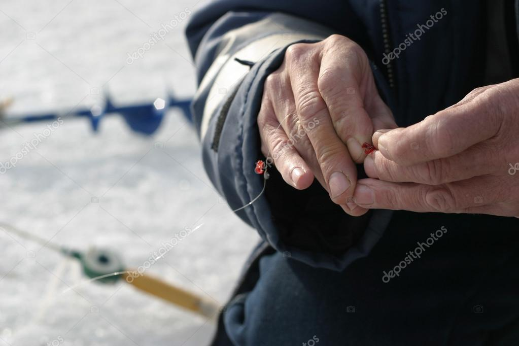 Fishing tips in the hands of the fisherman