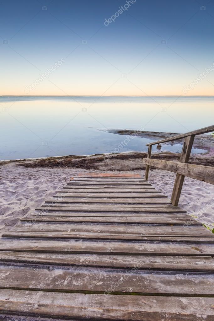 Фотообои wooden stairs leading to the sea