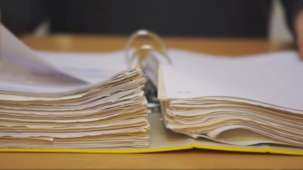 Open folder with documents. Entrepreneur studies financial documents. Hands holding fingers in page while reading