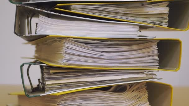 Finance documents in folders. Stacks of files and paperwork in the office: archive, work overload and management concept