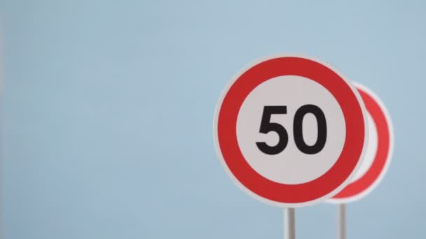 A road signs indicating a speed limit. Rotation