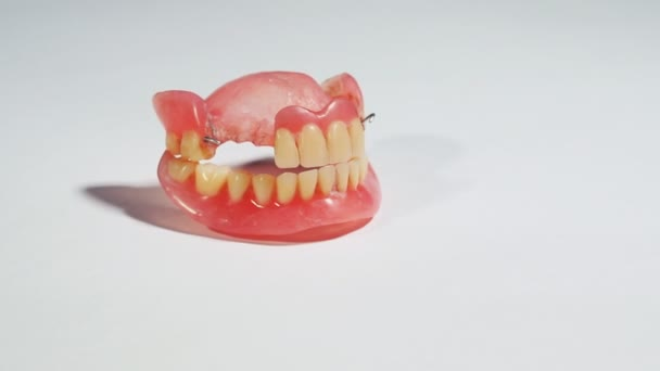 Dentures, removable false teeth made of acrylic. Close-up shot